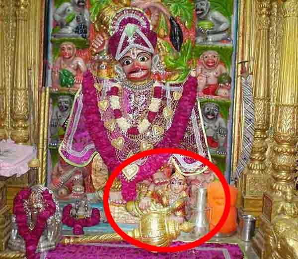 Why are you sitting in the woman's feet Hanuman Shani