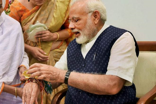 Ex-prostitute tied Rakhi to modi, want justice for all